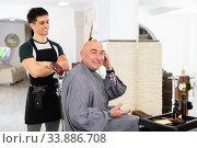 Купить «Satisfied male client in barbershop», фото № 33886708, снято 1 июня 2020 г. (c) Яков Филимонов / Фотобанк Лори