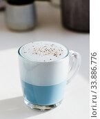 Купить «Blue pea latte or blue matcha latte with copy space», фото № 33886776, снято 23 апреля 2020 г. (c) Ольга Сергеева / Фотобанк Лори