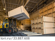 Купить «forklift load panels on furniture plant», фото № 33887608, снято 23 марта 2020 г. (c) Гурьянов Андрей / Фотобанк Лори