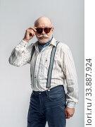 Купить «Elderly man with mustache poses in sunglasses», фото № 33887924, снято 7 февраля 2020 г. (c) Tryapitsyn Sergiy / Фотобанк Лори