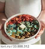 Купить «Colorful pancake cereal in baby hands», фото № 33888312, снято 29 мая 2020 г. (c) Ольга Сергеева / Фотобанк Лори