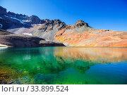 Купить «Serenity lake in the mountains in summer season. Beautiful natural landscapes.», фото № 33899524, снято 2 июня 2020 г. (c) easy Fotostock / Фотобанк Лори