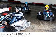 Купить «Young people driving sport cars for karting», фото № 33901564, снято 5 июля 2020 г. (c) Яков Филимонов / Фотобанк Лори