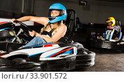 woman driving racing car at kart circuit. Стоковое фото, фотограф Яков Филимонов / Фотобанк Лори
