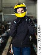 Купить «Lucky woman in helmet standing near sport cars», фото № 33901604, снято 18 марта 2019 г. (c) Яков Филимонов / Фотобанк Лори