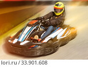 Купить «Woman driving sport car for karting in a circuit lap outdoor in», фото № 33901608, снято 18 марта 2019 г. (c) Яков Филимонов / Фотобанк Лори