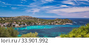 Купить «Panoramic image coastline of Santa Ponsa town in the south-west of Majorca Island. Located in the municipality of Calvia, moored yachts on the turquoise tranquil bay of Mediterranean Sea, Spain», фото № 33901992, снято 27 мая 2019 г. (c) Alexander Tihonovs / Фотобанк Лори