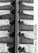 Купить «Rusty rail on concrete sleepers. Vertical black and white», фото № 33902036, снято 29 июня 2019 г. (c) EugeneSergeev / Фотобанк Лори