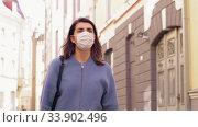Купить «woman wearing medical mask walking in city», видеоролик № 33902496, снято 28 мая 2020 г. (c) Syda Productions / Фотобанк Лори