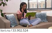 Купить «woman with diary sitting on sofa at home», видеоролик № 33902524, снято 24 мая 2020 г. (c) Syda Productions / Фотобанк Лори