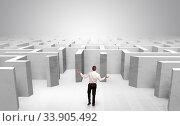 Купить «Businessman choosing between entrances in a middle of a maze», фото № 33905492, снято 8 июля 2020 г. (c) easy Fotostock / Фотобанк Лори