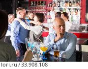 Купить «Sad bored man at corporate party», фото № 33908108, снято 25 марта 2019 г. (c) Яков Филимонов / Фотобанк Лори