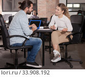 Купить «Male and female entrepreneurs discussing project», фото № 33908192, снято 16 марта 2019 г. (c) Яков Филимонов / Фотобанк Лори