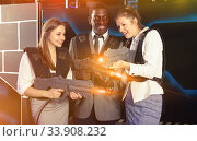 African man and joyful women holding laser guns. Стоковое фото, фотограф Яков Филимонов / Фотобанк Лори