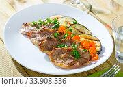 Купить «Slices of mutton with grilled eggplant», фото № 33908336, снято 4 июля 2020 г. (c) Яков Филимонов / Фотобанк Лори