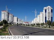 Купить «Wide boulevard with some new buildings. Ashkhabad. Turkmenistan.», фото № 33913108, снято 13 июля 2020 г. (c) age Fotostock / Фотобанк Лори