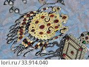Купить «National woman jewelry made of silver and semi-precious stones. Turkmenistan. Ashkhabad market.», фото № 33914040, снято 13 июля 2020 г. (c) age Fotostock / Фотобанк Лори