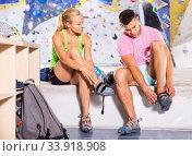 Купить «Pair of sports people dressing for mountaineering outfit for climbing», фото № 33918908, снято 4 июля 2020 г. (c) Яков Филимонов / Фотобанк Лори