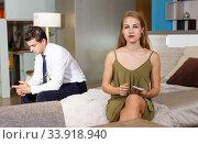 Купить «Upset woman with phone and with frustrated man», фото № 33918940, снято 24 сентября 2018 г. (c) Яков Филимонов / Фотобанк Лори