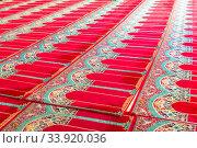 Купить «a carpet on the floor in a Muslim church for worshipers», фото № 33920036, снято 11 июня 2018 г. (c) Константин Лабунский / Фотобанк Лори