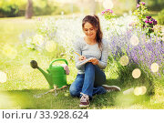 young woman writing to notebook at summer garden. Стоковое фото, фотограф Syda Productions / Фотобанк Лори