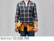 Купить «male worker or builder with working tools on belt», фото № 33928780, снято 21 ноября 2019 г. (c) Syda Productions / Фотобанк Лори