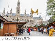 Купить «Stalls at the Christmas Market at Rathaus in Vienna at Christmas. Merry christmas, cute festive decoration, beautiful toys for new year», фото № 33928876, снято 24 ноября 2018 г. (c) Nataliia Zhekova / Фотобанк Лори