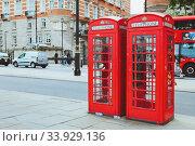 Купить «LONDON - AUGUST 23, 2017: Red telephone box and double decker bus», фото № 33929136, снято 23 августа 2017 г. (c) Nataliia Zhekova / Фотобанк Лори