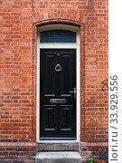 A black door in Dublin, Ireland. Arched Georgian door house front (2019 год). Стоковое фото, фотограф Nataliia Zhekova / Фотобанк Лори