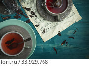 Dark and Moody, Mystic Light food photography. Pomegranate tea. Brewing tea. Стоковое фото, фотограф Nataliia Zhekova / Фотобанк Лори