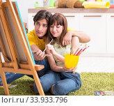 Купить «Young couple enjoying painting at home», фото № 33933796, снято 11 июля 2018 г. (c) Elnur / Фотобанк Лори