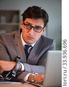 Купить «Businessman staying in the office for long hours», фото № 33936696, снято 18 октября 2016 г. (c) Elnur / Фотобанк Лори
