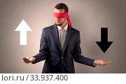 Купить «Covered eye businessman choosing between two directions», фото № 33937400, снято 8 июля 2020 г. (c) easy Fotostock / Фотобанк Лори