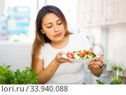 Portrait of smiling latino woman serving fresh healthy salad. Стоковое фото, фотограф Яков Филимонов / Фотобанк Лори