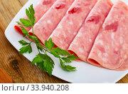 Sliced chopped pork sausage. Стоковое фото, фотограф Яков Филимонов / Фотобанк Лори