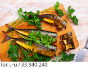 Slices of smoked mackerel served with greens. Стоковое фото, фотограф Яков Филимонов / Фотобанк Лори