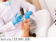 Woman receiving rejuvenating facial injections. Стоковое фото, фотограф Яков Филимонов / Фотобанк Лори