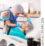 Cosmetologist giving consultation to woman patient. Стоковое фото, фотограф Яков Филимонов / Фотобанк Лори