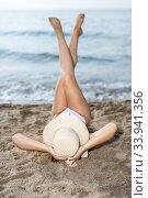 Купить «Closeup of young woman in swimsuit and hat taking sunbath», фото № 33941356, снято 10 июля 2018 г. (c) Яков Филимонов / Фотобанк Лори
