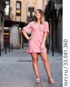 Купить «Young positive female standing in the historical center of Barcelona», фото № 33941360, снято 7 июля 2020 г. (c) Яков Филимонов / Фотобанк Лори