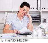 Thinking female in office sitting at the table. Стоковое фото, фотограф Яков Филимонов / Фотобанк Лори