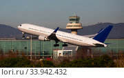 Купить «Image of passenger airplane take-off from airport», фото № 33942432, снято 2 февраля 2020 г. (c) Яков Филимонов / Фотобанк Лори
