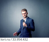 Купить «Businessman speaking into microphone with blue background», фото № 33954432, снято 14 июля 2020 г. (c) easy Fotostock / Фотобанк Лори