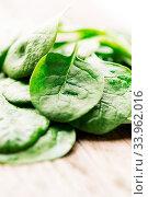Купить «Spinach leaves on wooden background», фото № 33962016, снято 6 июля 2020 г. (c) age Fotostock / Фотобанк Лори