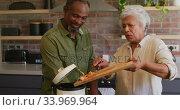 Купить «Senior African American husband and mixed race wife cooking together at home», видеоролик № 33969964, снято 19 февраля 2020 г. (c) Wavebreak Media / Фотобанк Лори