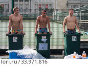 Купить «Singapore, Republic of Singapore, Asia - After a match at the Rugby Sevens tournament three rugby players of the France Development Team take an ice bath...», фото № 33971816, снято 14 июля 2020 г. (c) age Fotostock / Фотобанк Лори