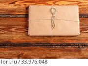 Купить «Gift Packed in eco-friendly biodegradable cardboard on dark old wooden background with blank space for text. top view. flat lay», фото № 33976048, снято 10 июля 2020 г. (c) easy Fotostock / Фотобанк Лори