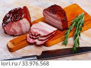 Купить «Sliced smoked pork belly», фото № 33976568, снято 6 июля 2020 г. (c) Яков Филимонов / Фотобанк Лори