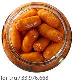 Купить «Open jar with preserved mini sausages», фото № 33976668, снято 5 июля 2020 г. (c) Яков Филимонов / Фотобанк Лори