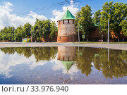 Купить «Arsenal tower of the Kremlin with reflection in Nizhny Novgorod», фото № 33976940, снято 23 июня 2019 г. (c) Дмитрий Тищенко / Фотобанк Лори